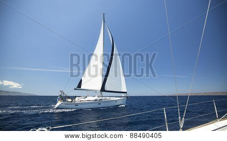 Ship yachts with white sails in the open Sea. Luxury boats. Sailing.