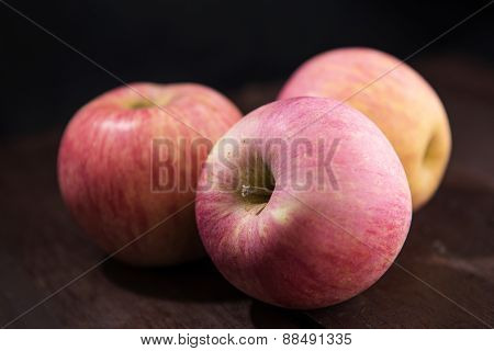 Apples On Wooden Table.