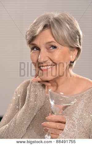 elderly woman in gray