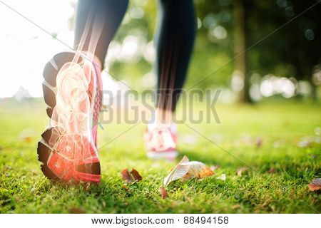 Digital composite of Highlighted foot bones of jogging woman