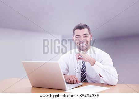 Businessman smiling against abstract room
