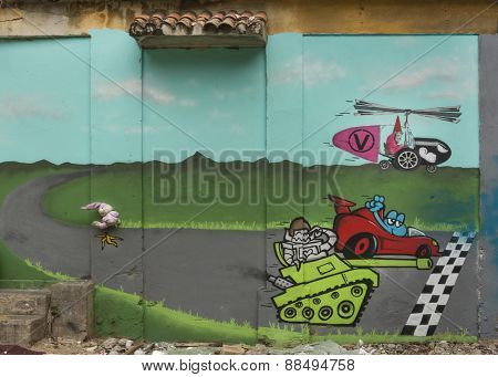 Graffiti Of A Race Between Tank, Car And Helicopter.