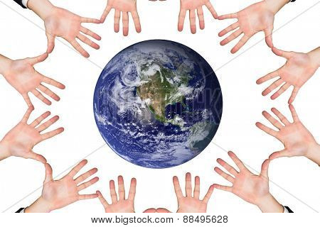 Circle of hands against earth