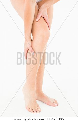 Natural woman with knee pain on white background
