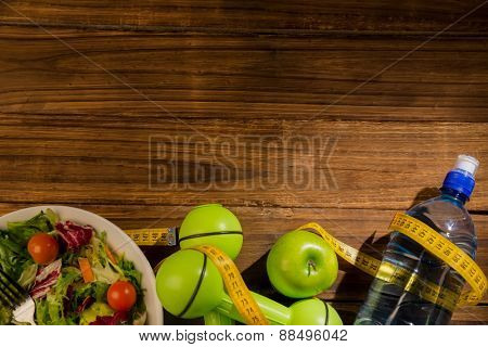 Indicators of healthy lifestyle on wooden table