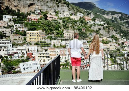 Couple Holding Hands In Positano, Italy
