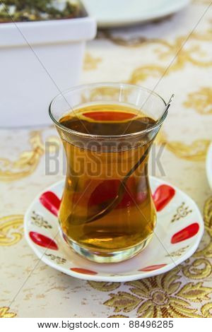 apple Turkish tea in a traditional cup in a cafe