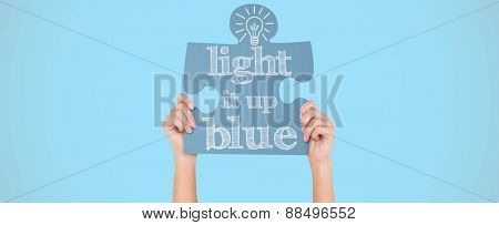 Hands showing jigsaw puzzle against blue background with vignette