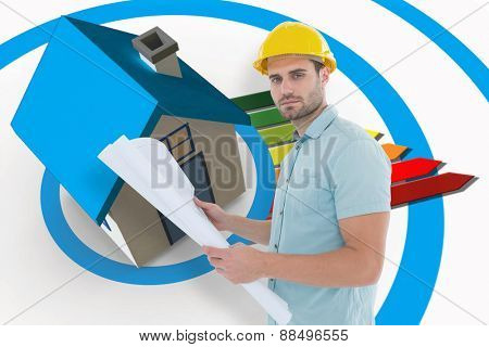 Confident male architect holding blueprint against energy ratings colour chart coming from 3d house