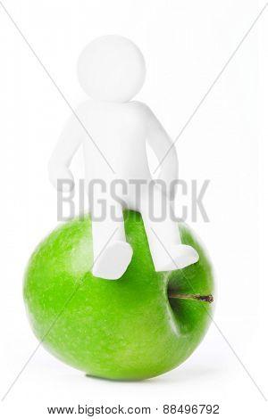 Plasticine man sitting on apple isolated on white background