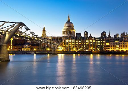 View of St. Paul's Cathedral and the Millennium Bridge in London over river Thames
