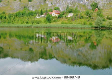 peacefull farm landscape reflected in Komarnica River, Montenegro