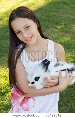 Cute Beautiful Smiling Teen Girl Holding At White-black Rabbit