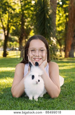 Cute Beautiful Smiling Teen Girl With White-black Baby Rabbit