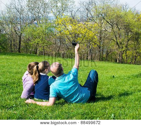 Group Of Smiling Friends  Taking Selfie In The Park