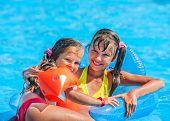 stock photo of mattress  - Little girl swimming on inflatable beach mattress - JPG