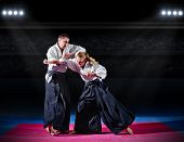 picture of aikido  - Fight between two aikido fighters at sport hall - JPG