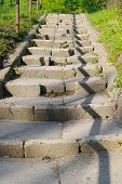 stock photo of balustrade  - damaged stone stairs with a balustrade shadow - JPG