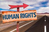 stock photo of human rights  - Human Rights sign with road background - JPG