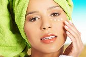 picture of turban  - Woman in bathrobe and turban with eye cream - JPG