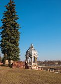 picture of gazebo  - Landscape with an old gazebo in the park and high spruce - JPG