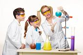 image of chemistry  - Teens and teacher of chemistry at chemistry lesson making experiments isolated on white background - JPG
