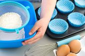 stock photo of fingernail  - Boy or Girl Baking sieving flour with clean hands and fingernails - JPG
