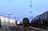 image of railcar  - Oil tank cars standing on rail tracks in industrial area - JPG