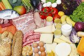 stock photo of food groups  - Assortment of food grouped by typology meat fish vegetables fruit dairies - JPG