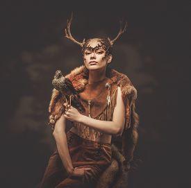 picture of hawk  - Woman shaman in ritual garment with hawk - JPG
