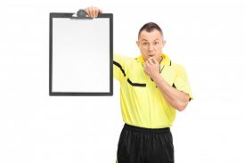 picture of referee  - Angry football referee in a yellow shirt blowing a whistle and showing a blank paper on a clipboard isolated on white background - JPG