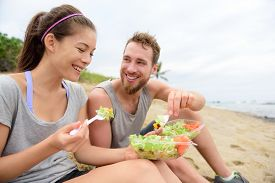 stock photo of takeaway  - Happy young people eating healthy salad for lunch - JPG