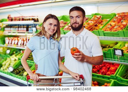 Young couple buying products in supermarket