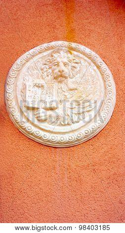 Lion In Circular Shape Bas Relief Art On Orangel Wall