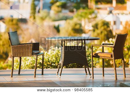 Home Exterior With Table And Chairs In Wooden Terrace