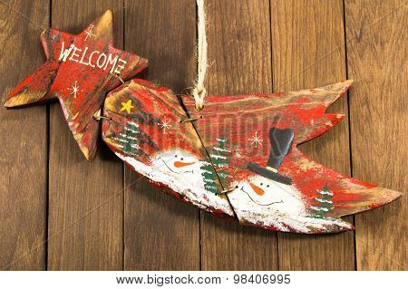 Hanged Red Wooden Decoration Comet Star Shaped On Wooden Background