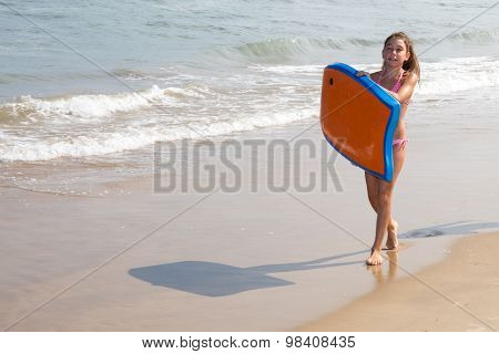 Pretty Girl On Blue Body Board On The Sand