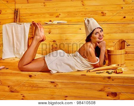 Young woman in sauna. Health and beauty
