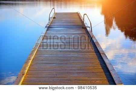boardwalk leads out onto the lake,  lake while sunrise