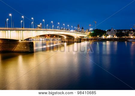 Night View Of Deutz Suspension Bridge Over River Rhine, Germany.