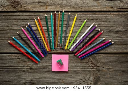 pensil, pen and other  school supplies on wooden table.