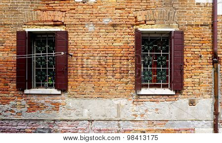 Two Windows With Brick Decay Wall Building