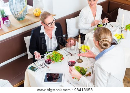 Businesswomen meeting at business dinner or lunch in Restaurant