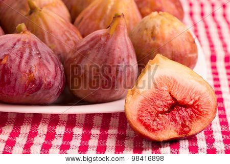 Group of figs in a white plate