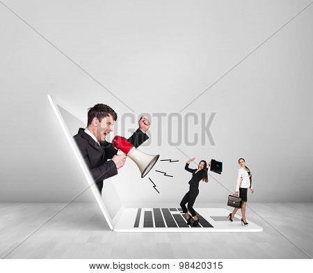 Businessman with megaphone get out of laptop