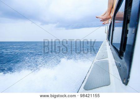 Feet On The Speedboat Across The Sea Go To Paradise Island
