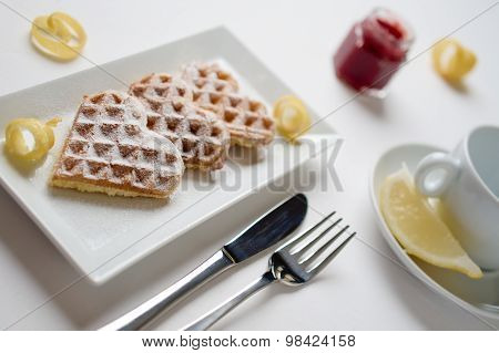 Heart Waffles Lemon Zest, Powdered Sugar Served On Rectangular Plate