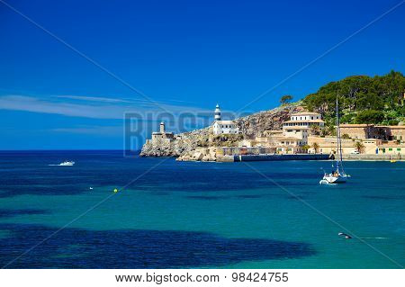 Small Lighthouse At The Pier Of Port De Soller