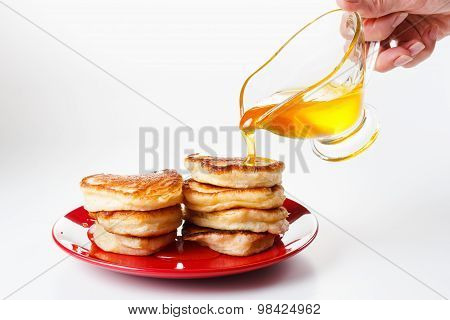 Chef Pours Sweet Syrup On Pancakes. White Background