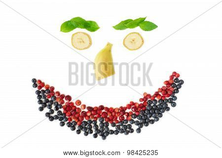 Smilling face from berries and fruits